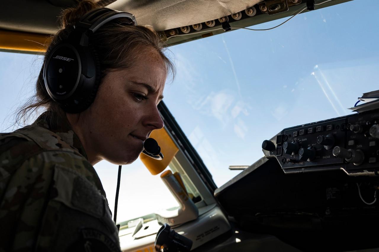 A female pilot flies an aircraft.