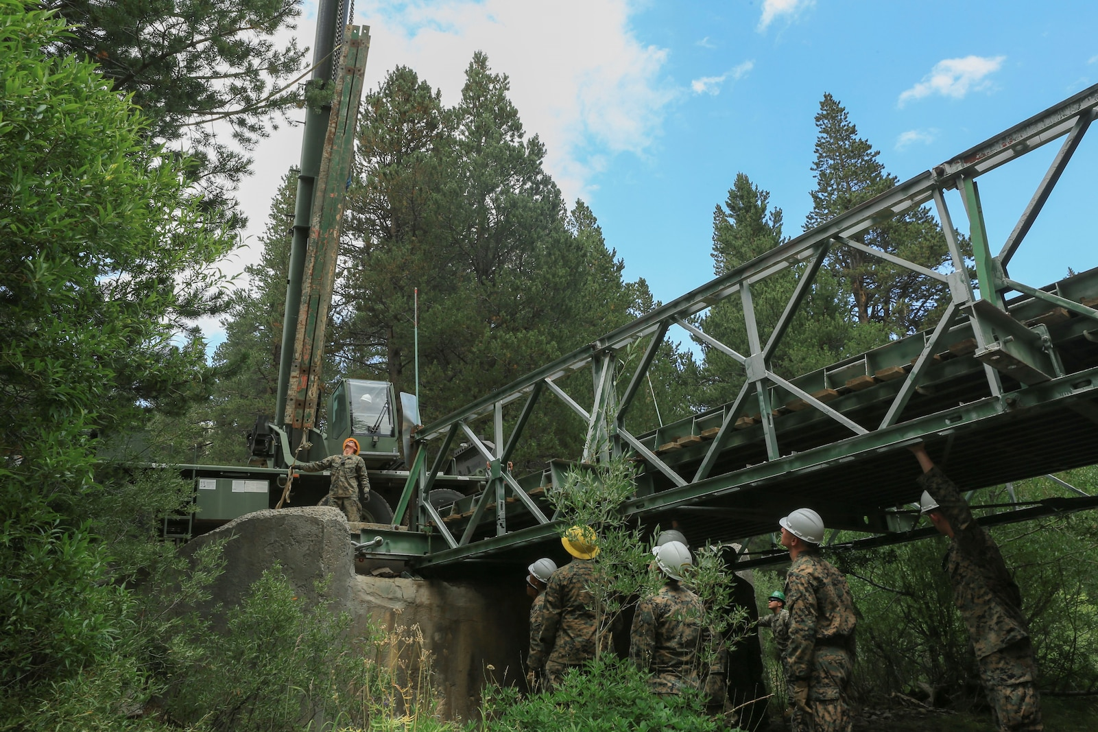 Marines with 7th Engineer Support Battalion conduct non-standard bridging to reinforce a bailey bridge.