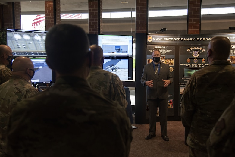 Christopher Leonard, 423rd Mobility Training Squadron Rapid Global Mobility Course instructor, explains what students learn during RGMC to Total Force Mobility Air Forces leadership during Total Force Phoenix Rally, April 21, 2021, at the U.S. Air Force Expeditionary Center headquarters on Joint Base McGuire-Dix-Lakehurst, New Jersey. U.S. Air Force Expeditionary Operations School instructors were given the opportunity to showcase how they contribute to AMC and its mission. (U.S. Air Force photo by Master Sgt. Ashley Hyatt)