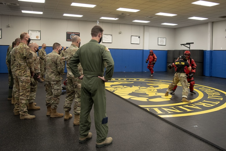 Phoenix Raven Qualification Course instructors assigned to the 421st Combat Training Squadron demonstrate how to neutralize a threat to Total Force Mobility Air Forces leadership during Total Force Phoenix Rally, April 21, 2021, at the U.S. Air Force Expeditionary Center headquarters on Joint Base McGuire-Dix-Lakehurst, New Jersey. U.S. Air Force Expeditionary Operations School instructors were given the opportunity to highlight how they contribute to AMC at its mission. (U.S. Air Force photo by Master Sgt. Ashley Hyatt)
