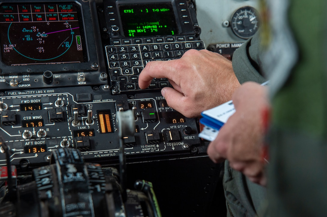 Capt. Vincent T. Jovene III, a 91st Air Refueling Squadron instructor pilot, inputs preflight information into the navigational system on a KC-135 Stratotanker aircraft on MacDill Air Force Base, Fla., April 18, 2021. Jovene conducted pre-flight operations to prepare for an air refueling support mission during the last day of the SUN 'n FUN Aerospace Expo located in Lakeland, Fla. (U.S. Air Force photo by Airman 1st Class David D. McLoney)