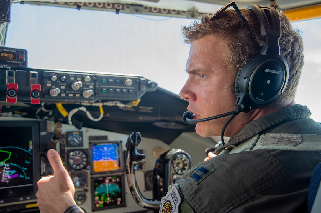Capt. Vincent T. Jovene III, a 91st Air Refueling Squadron instructor pilot, signals to his co-pilot while flying a KC-135 Stratotanker aircraft from MacDill Air Force Base, Fla., April 18, 2021. Jovene III and Capt. Giovanny Parra, a 91st ARS pilot, provided air refueling support to an F-22 Raptor and an A-10 Thunderbolt II after the SUN 'n FUN Aerospace Expo located in Lakeland, Fla. (U.S. Air Force photo by Airman 1st Class David D. McLoney)