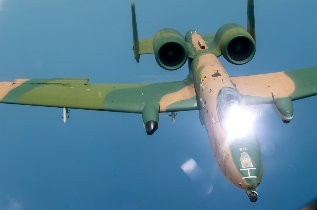 An A-10 Thunderbolt II aircraft flies through the air after being refueled by a KC-135 Stratotanker aircraft from MacDill Air Force Base, Fla., April 18, 2021.  The A-10, with its new paint job, participated in the SUN 'n FUN Aerospace Expo located in Lakeland, Fla., as well as the Cocoa Beach Air Show. (U.S. Air Force photo by Airman 1st Class David D. McLoney)