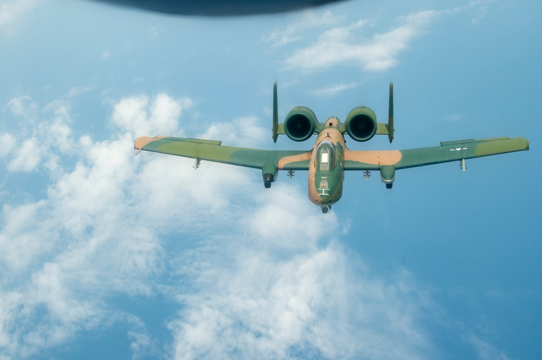 An A-10 Thunderbolt II aircraft flies through the air after being refueled by a KC-135 Stratotanker from MacDill Air Force Base, Fla., April 18, 2021. The A-10 performed during the SUN 'n FUN Aerospace Expo earlier that day, during a heritage flight with an F-22 Raptor aircraft and a P-51 Mustang aircraft. (U.S. Air Force photo by Airman 1st Class David D. McLoney)