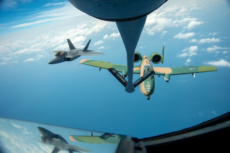 An F-22 Raptor aircraft and an A-10 Thunderbolt aircraft II fly through the air after being refueled by a KC-135 Stratotanker from MacDill Air Force Base, Fla., April 18, 2021, after performing for the SUN 'n FUN Aerospace Expo located in Lakeland, Fla. The Expo is the second largest air show in the world, with over 225,000 enthusiasts visiting to experience the 377 exhibitors that participated in the event. (U.S. Air Force photo by Airman 1st Class David D. McLoney)