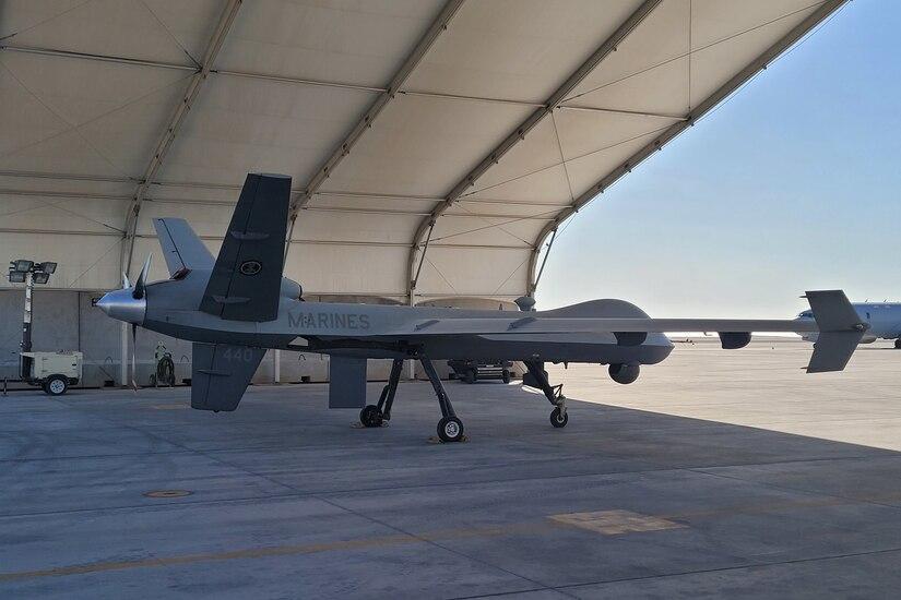 A drone sits inside a hangar.
