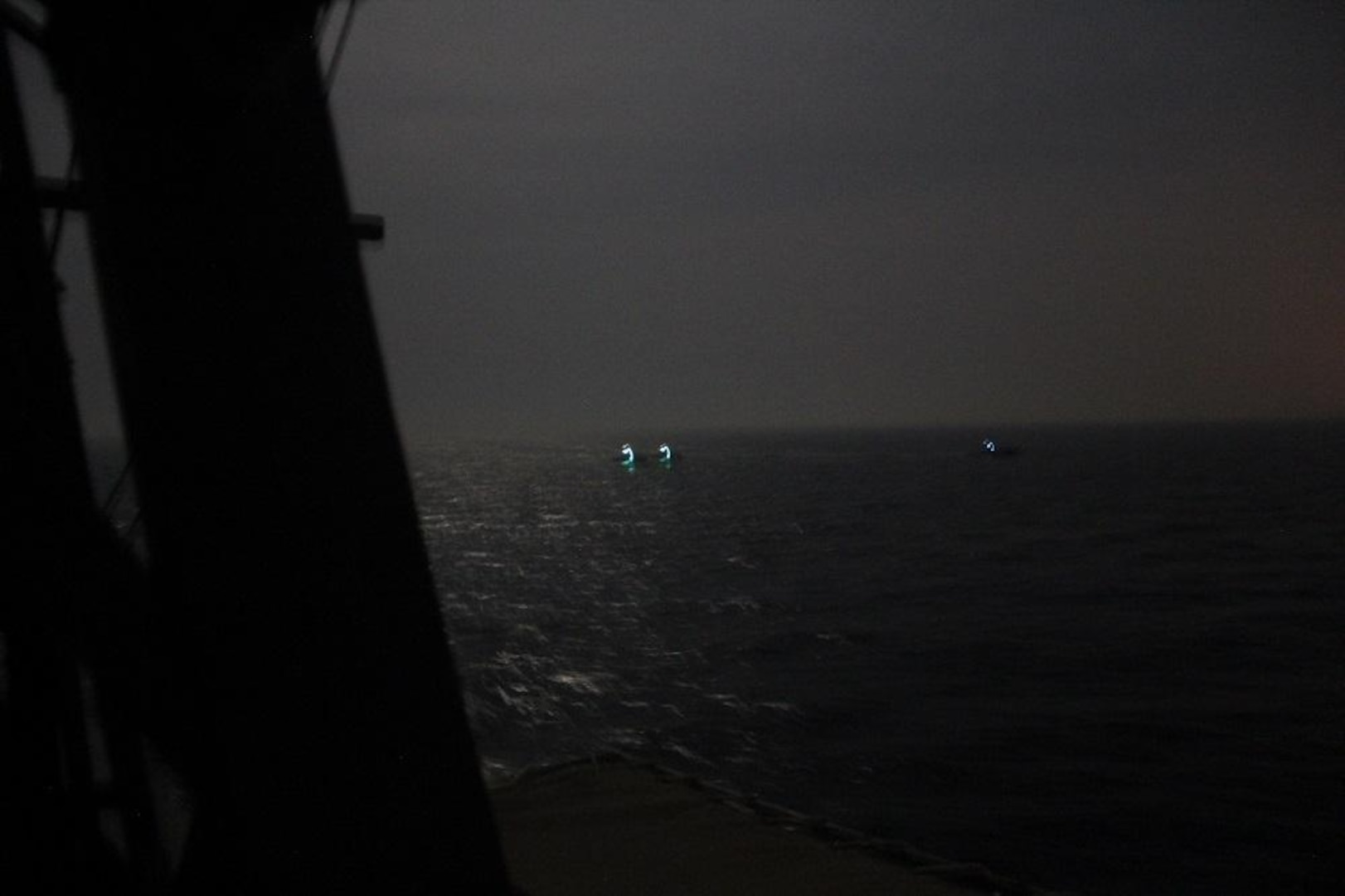 210426-N-NO146-1005 ARABIAN GULF (April 26, 2021) Three Iranian Islamic Revolutionary Guard Corps Navy (IRGCN) fast inshore attack craft (FIAC) approach the patrol coastal ship USS Firebolt (PC 10), while the U.S. vessel was conducting routine maritime security patrols in the international waters of the North Arabian Gulf, April 26. Firebolt is assigned to U.S. Naval Forces Central Command's Task Force (TF) 55. (U.S. Navy Photo)