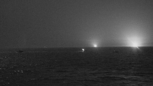Three Iranian Islamic Revolutionary Guard Corps Navy (IRGCN) fast inshore attack craft (FIAC) approach the U.S. Coast Guard patrol boat USCGC Baranof (WPB 1318) and patrol coastal ship USS Firebolt (PC 10), while the U.S. vessels were conducting routine maritime security patrols in the international waters of the North Arabian Gulf, April 26.