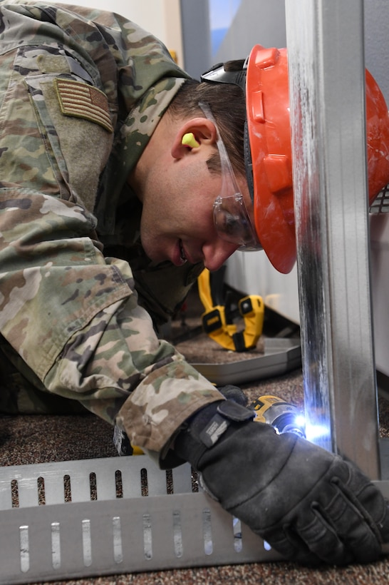 Airman 1st Class Evan Offie is a structural journeyman in the 168th Wing Civil Engineering Squadron, learning the trade and serving in the Air National Guard. (U.S. Air National Guard photo by Senior Master Sgt. Julie Avey)