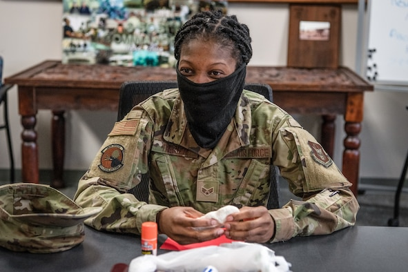 A female Airman molds a piece of clay.