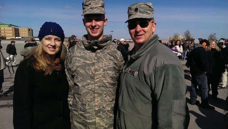 Staff Sgt. Brendan Miller, Armed Force Network Tokyo broadcaster, poses with his father, Lt. Col. Mark Miller, and his mother, Laura Miller, after graduating Air Force Military Training, Nov. 19, 2014 at Lackland Air Force Base, San Antonio, Texas.