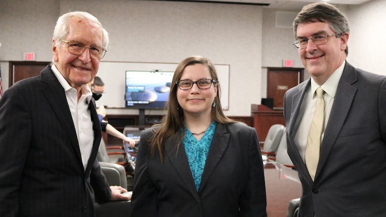 Former Air University Library Director Robert Lane (left) joined the library staff to help them celebrate the library's 75th anniversary, April 1, 2021. Lane was director from 1974-2000. Lane is pictured with current AU Library Director Alisha Miles and AU Academic Services Director Dr. Mehmed Ali.