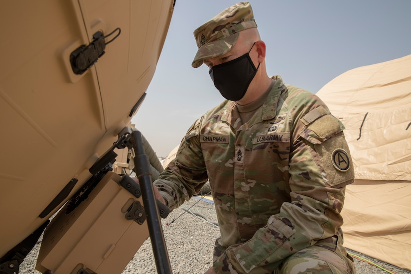 Army Master Sgt. Brian Chapman, Information Systems Division Non-commissioned Officer in Charge for U.S. Army Central G6 adjusts their Tampa 1.3M satellite dish during validation for the new Relocatable Emergency Command Post at Camp Arifjan, Kuwait, April 12 2021. This technology further develops the capabilities and increases the U.S. Armed Forces overall readiness. (Photo by U.S. Army Sgt. Robert Torres, USARCENT PAO)