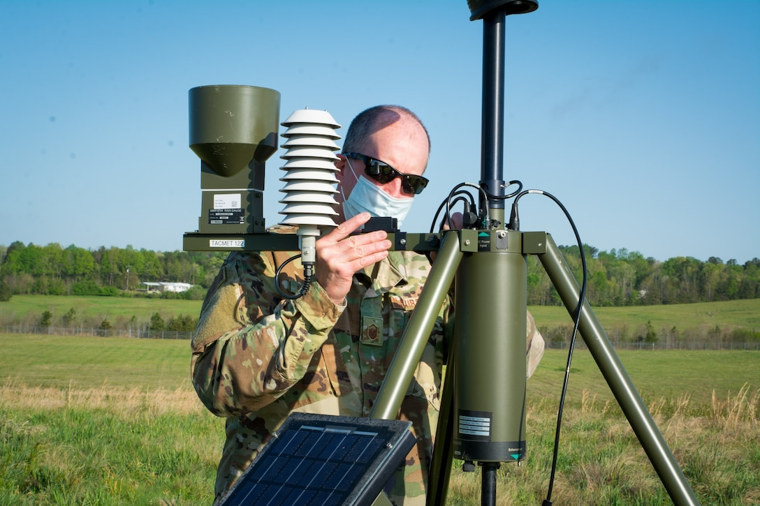 An Airman with the 156th Weather Flight (WF) attaches a rain gauge and temperature sensor to a TMQ-53 portable weather station during training held at the regional training site in New London, N.C., April 11, 2021. The training the 156th WF conducts is conducted a few times a year to keep members current on their annual position qualification.