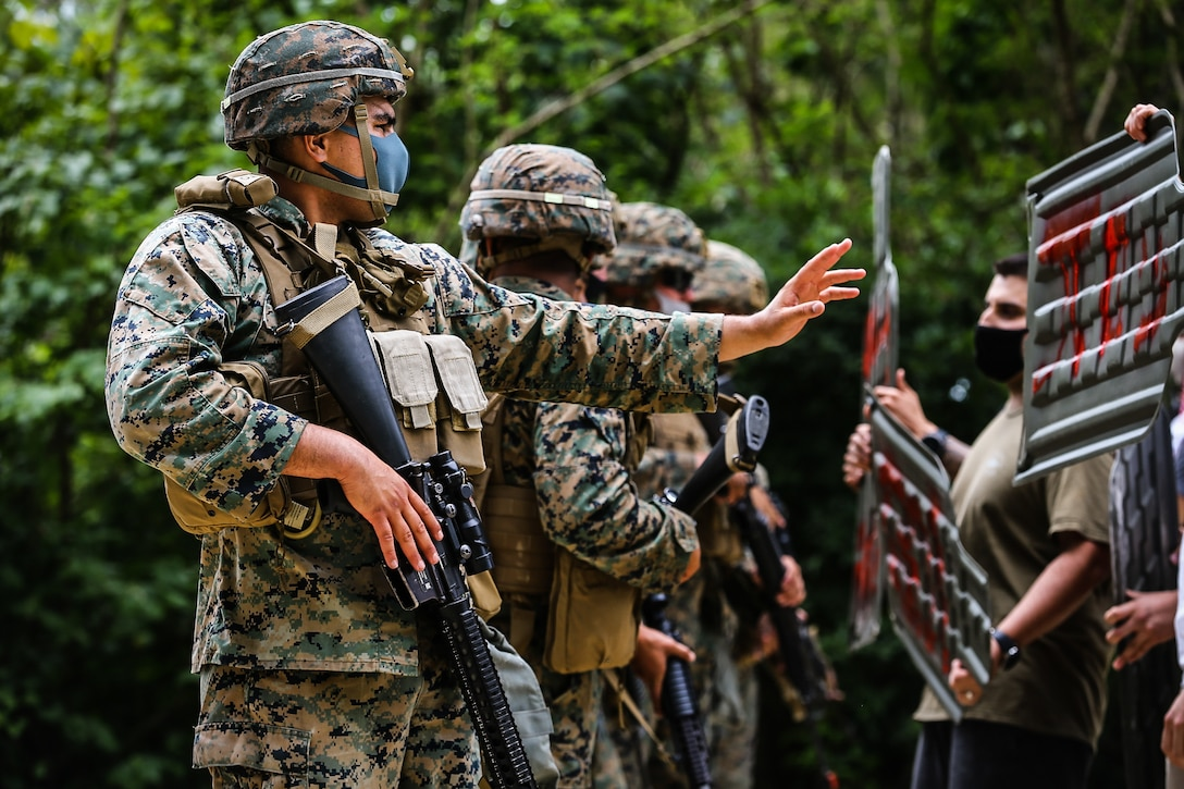 U.S. Marines warn notional protestors to move back using appropriate escalation of force tactics in Okinawa, Japan, April 21.