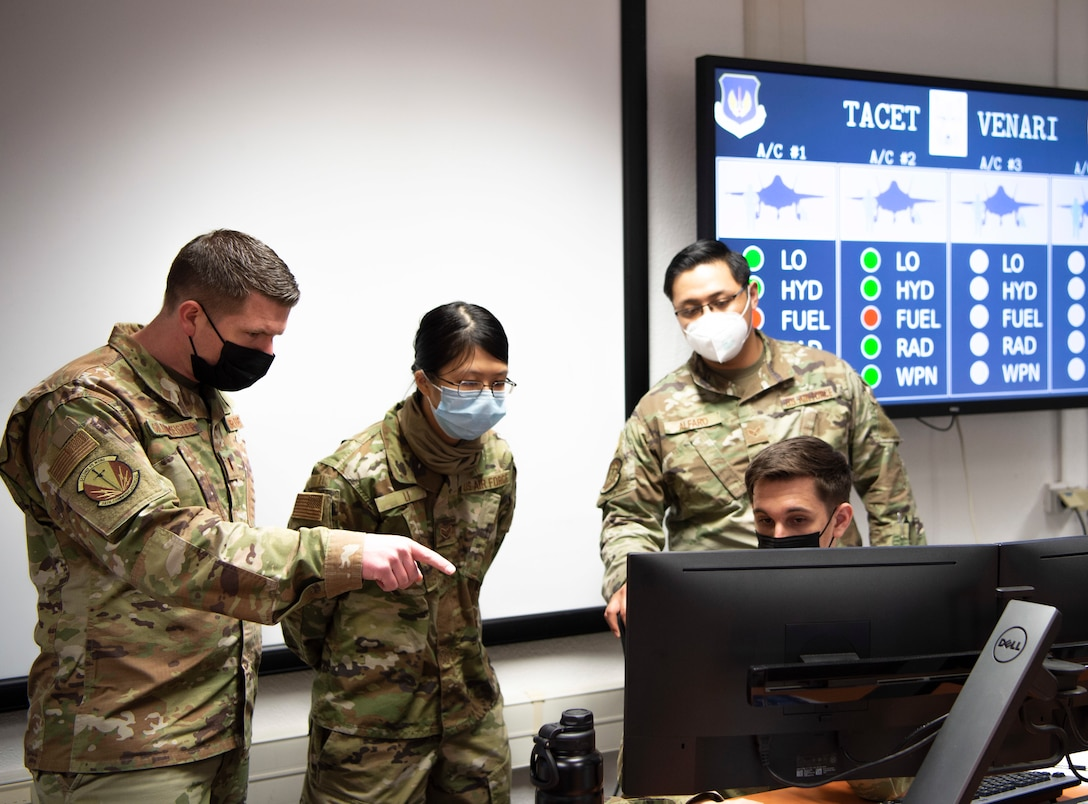 2nd Lt. Nicholas Gildenmeister, 86th Communication Squadron; Senior Airman Rose Li 86th CS; Senior Airman Dakota Lindberg, 52nd CS; and Senior Airman Marj Alfaro, 52nd CS, participate in the USAFE-led cyber exercise, Tacet Venari, at Ramstein Air Base, Germany, April 22, 2021. Tacet Venari is Latin for Silent Hunt, which describes the goal of the exercise: to hunt for adversaries within USAFE-AFAFRICA weapons systems. The exercise is one of several DoD-wide efforts to provide mission assurance and enhance command and control by providing warfighters the skills needed to deliver defensive cyber operations. (U.S. Air Force photo by 1st Lt. Hannah Durbin)