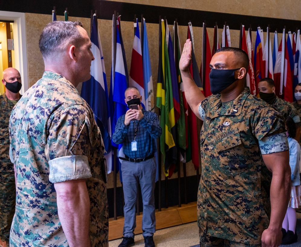 Former first sergeant, Alberto Andino, swears in during his commissioning as a second lieutenant at Marine Corps Embassy Security Group, in Quantico, Va., March 31.