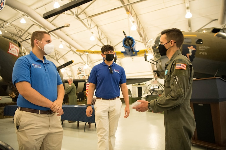 A group of Delaware State University students conversing with a Dover Air Force Base pilot.