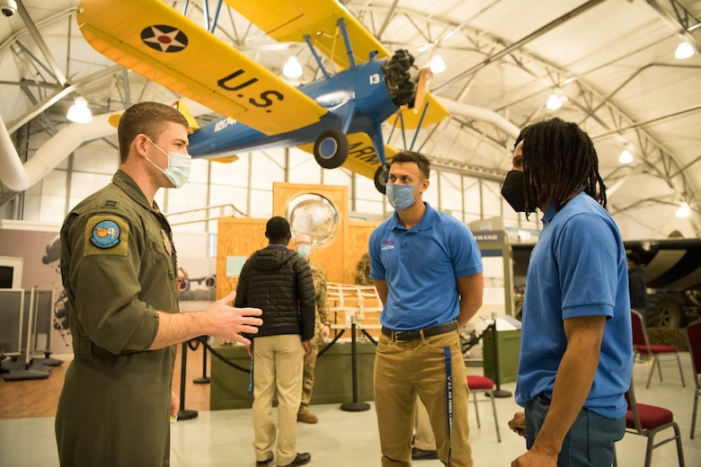 A group of Dover State University Students conversing with a Dover Air Force Base Pilot.