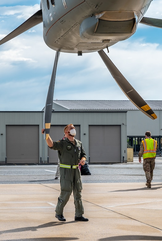 A German air force airman checks the propeller of an A-400M Atlas as they prepare for takeoff after completing a foreign military sales mission at Dover Air Force Base, Delaware, April 19, 2021. Germany is a key NATO ally, helping to strengthen regional security and encourage peace and unity in Europe. Dover AFB's FMS mission supports approximately $3.5 billion worth of equipment annually. (U.S. Air Force photo by Senior Airman Christopher Quail)