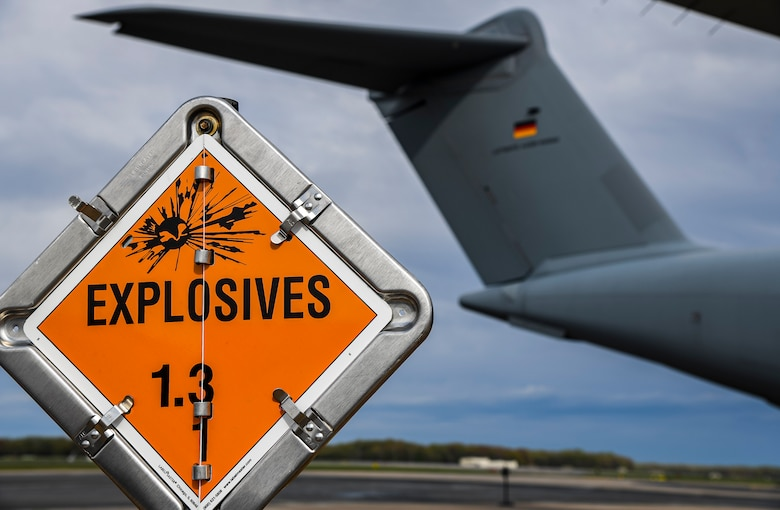 An explosive sign marks the cordon around a German air force A-400M Atlas during a foreign military sales mission at Dover Air Force Base, Delaware, April 19, 2021. As NATO allies, the United States and Germany work side by side to maintain and build peace and stability throughout Europe and the world. Dover AFB's FMS mission supports approximately $3.5 billion worth of equipment annually. (U.S. Air Force photo by Airman 1st Class Stephani Barge)
