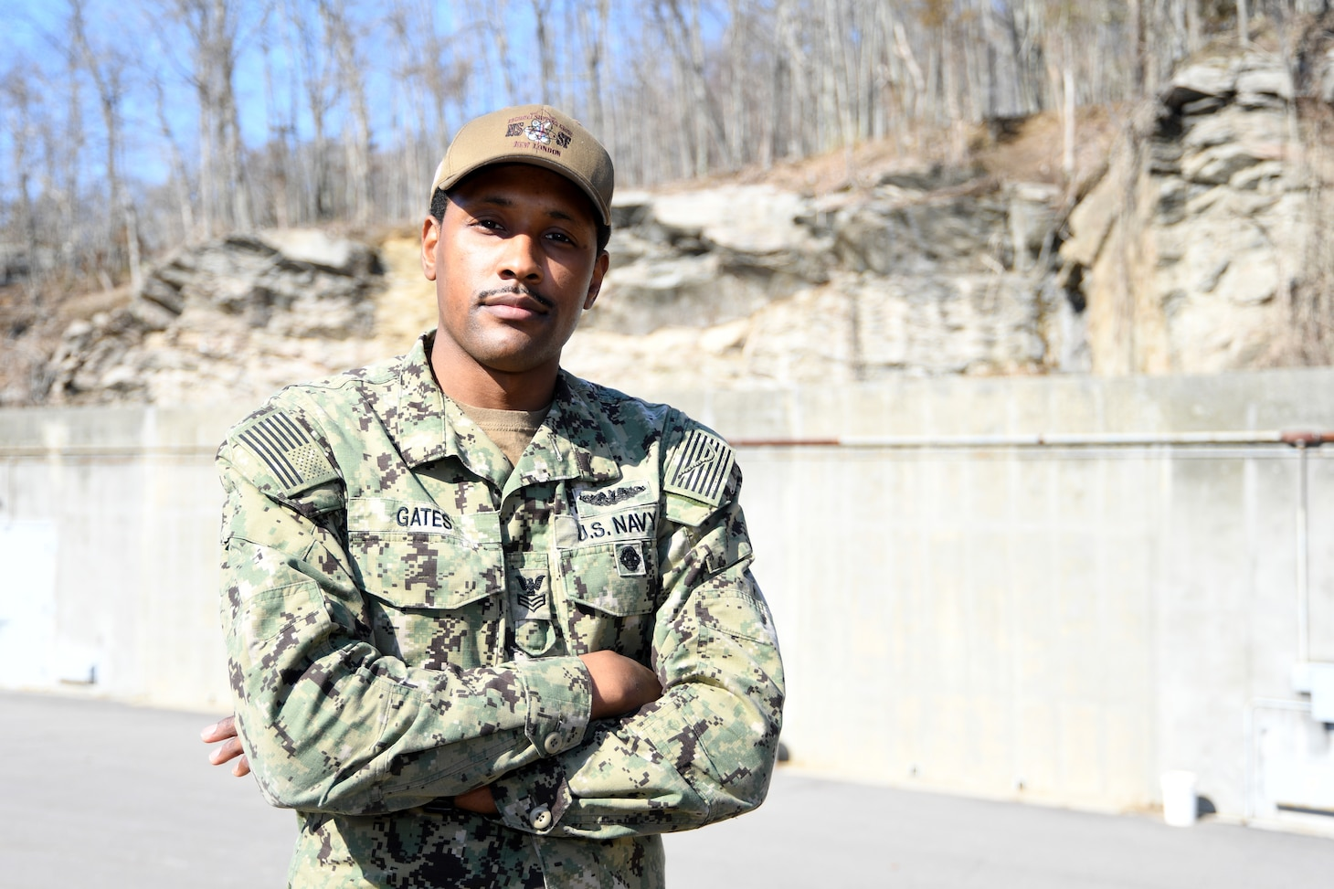 Torpedoman's Mate 1st Class Raymond Gates, assigned to Naval Submarine Support Facility, Regional Support Group, poses for a photo at Naval Submarine Base New London in Groton, Conn.