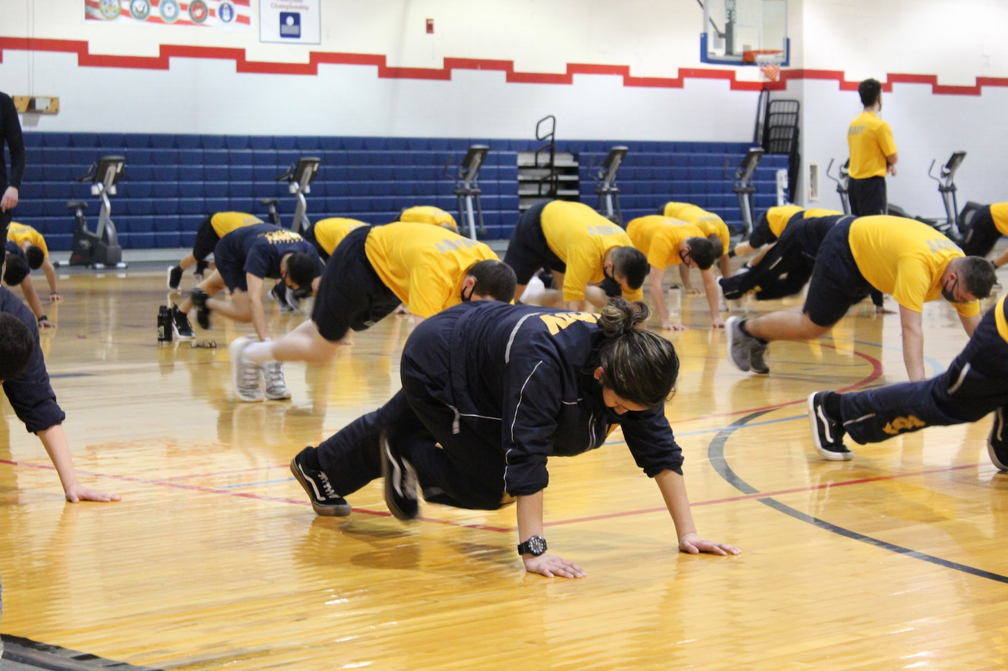 GREAT LAKES, Ill. (March 8, 2021) Training Support Center (TSC) Great Lakes Command Fitness Leaders (CFL) and fitness specialists implementing physical fitness efforts following pause due to COVID 19. Physical training will be conducted, adhering to virus mitigation rules, by CFL and TSC staff volunteers utilizing Navy Operational Fitness and Fueling Series (NOFFS) and authorized Navy Fitness routines.  (U.S. Navy photo by FCSA Elizabeth Jordan /Released)