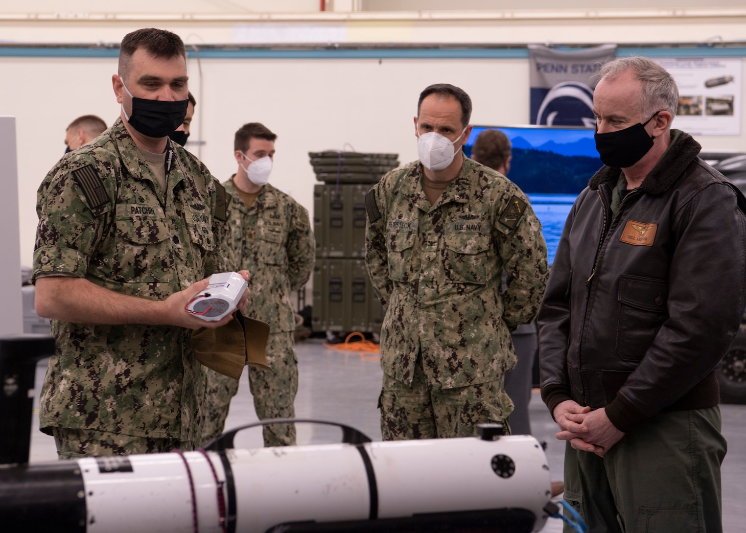 Cmdr. Rob Patchin, commanding officer of Unmanned Undersea Vehicle Squadron (UUVRON) 1, demonstrates battery endurance of a small-class unmanned undersea vehicle to Capt. Lincoln Reifsteck.