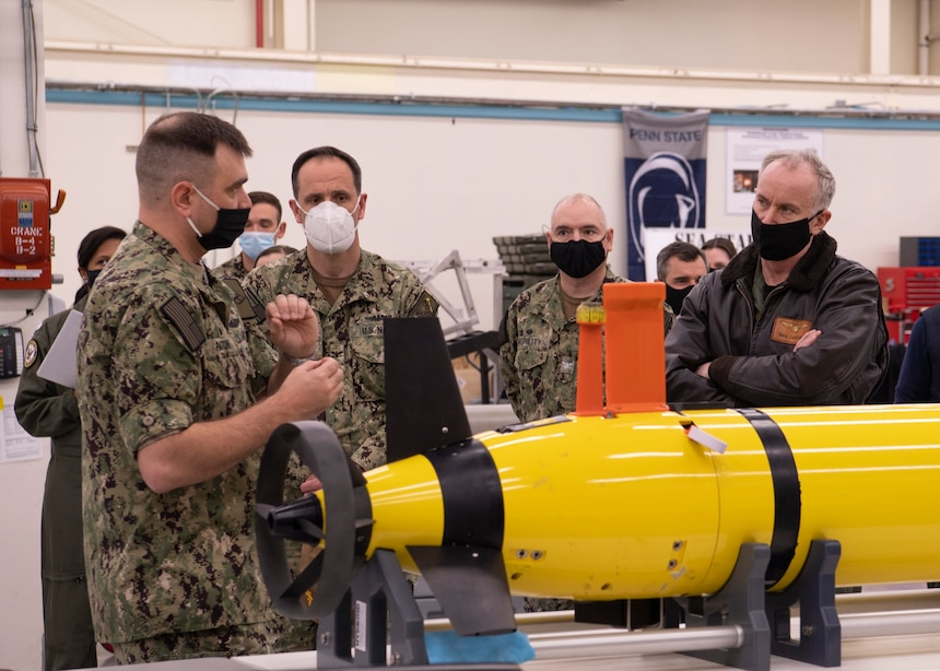 Cmdr. Rob Patchin, commanding officer of Unmanned Undersea Vehicle Squadron  (UUVRON) 1, explains the capabilities of a Razorback unmanned undersea vehicle to Capt. Lincoln Reifsteck.