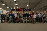Members of the Task Force Distribution team pose for a photo at the Concord warehouse, April 23, 2021. After a year of operations, Task Force Distribution has made over 30,000 deliveries consisting of 17,000 tons of personal protective equipment throughout the state of N.H. Photo by Pfc. Devin Bard, 114th Public Affairs Detachment.