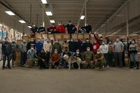 Members of the Task Force Distribution team pose for a photo at the Concord warehouse, April 23, 2021.