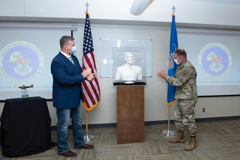 Samuel A. Turner and Col. David Doss, the 28th Bomb Wing commander, unveil the Samuel O. Turner Heritage Sculpture at Ellsworth Air Force Base, S.D., April 20, 2021.