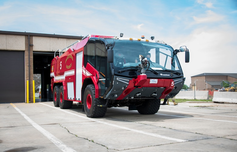 A new fire truck sits outside the base fire station, April 26, 2021, at Altus Air Force Base, Oklahoma. The new fire truck can reach speeds up to 85 miles per hour. (U.S. Air Force photo by Airman 1st Class Amanda Lovelace)