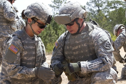 Vermont became the first state to allow women into all combat arms units April 28, 2021, following authorization issued by the National Guard Bureau. Pictured, Spc. Maryi Burnside (left) and Sgt. Vic Harper, both assigned to the Florida National Guard's 779th Engineer Battalion, prepare a piece of detonation cord that will be attached to a block of composition C4 at McCrady Training Center April 10, 2016. (U.S. Army photo)