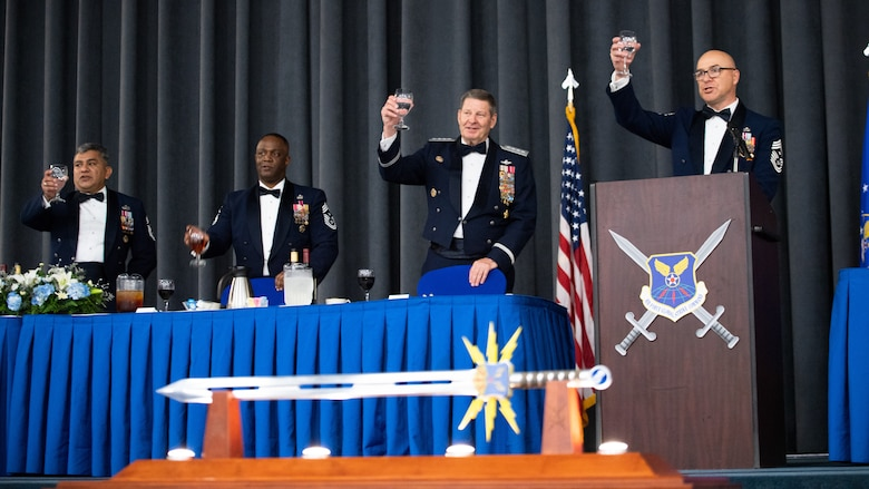 Retired Gen. Robin Rand, second from right, former Air Force Global Strike Command commander, and his former Command Chief Master Sgts. make a toast during an Order of the Sword ceremony at Barksdale Air Force Base, Louisiana, April 23, 2021. The Order of the Sword is a rare honor bestowed on a senior officer or civilian by the enlisted corps of a command. (U.S. Air Force photo by Airman 1st Class Jacob B. Wrightsman)
