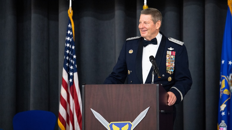 Retired Gen. Robin Rand, former Air Force Global Strike Command commander, makes remarks after being honored at an Order of the Sword ceremony at Barksdale Air Force Base, Louisiana, April 23, 2021. The Order of the Sword is a rare honor bestowed on a senior officer or civilian by the enlisted corps of a command. (U.S. Air Force photo by Airman 1st Class Jacob B. Wrightsman)