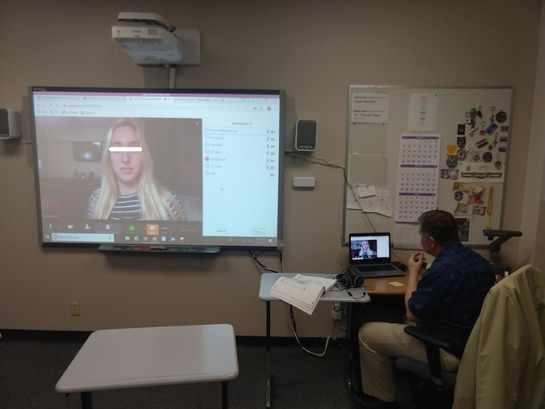 Zoom allows students and teachers to converse face-to-face while not even being in the classroom. Here an instructor is able to uphold the important face-to-face portion of language learning even at a distance. The COVID-19 pandemic generated rapid growth and innovation at DLIELC, with the team being afforded the opportunity to test the implementation of open source and government technologies to continue their mission of language education, despite geographical separation for faculty and students. (U.S. Air Force photo)