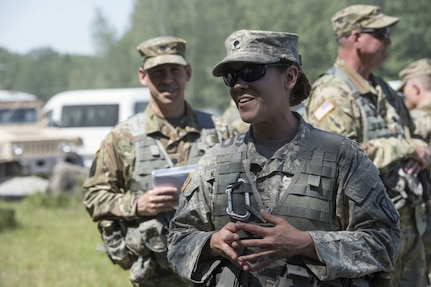 U.S. Army Spc. Gloria Kamencik, a scout with Alpha Troop, 1st Squadron, 172nd Calvary Regiment, 86th Infantry Brigade Combat Team (Mountain), Vermont National Guard, speaks to Vermont State representatives at Fort Drum, N.Y., June 15, 2017. The representatives had an opportunity to speak with and visit multiple Soldiers during their summer annual training. (U.S. Air National Guard photo by Tech. Sgt. Sarah Mattison)