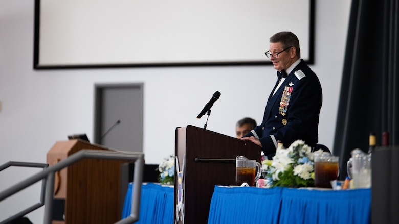 Retired Gen. Robin Rand, former Air Force Global Strike Command commander, makes remarks after being honored at an Order of the Sword ceremony at Barksdale Air Force Base, Louisiana, April 23, 2021. The Order of the Sword is a rare honor bestowed on a senior officer or civilian by the noncommissioned officers of a command to recognize individuals who have made significant contributions to the enlisted corps. (U.S. Air Force photo by Airman 1st Class Jacob B. Wrightsman)