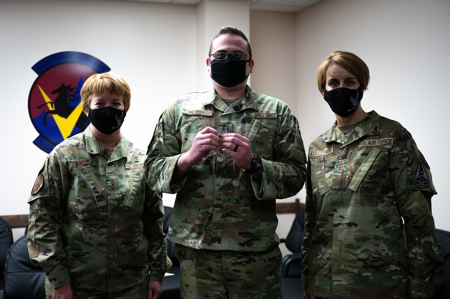 U.S. Air Force Lt. Gen. Dorothy A. Hogg, Air Force Surgeon General, Staff Sgt. Brandon Mercer, a 356th Fighter Squadron Independent Duty Medical Technician (IDMT), and Chief Master Sgt. Dawn Kolczynski, Chief, Medical Enlisted Force and Enlisted Corps Chief, pose for a photo during a leadership visit at Eielson Air Force Base, Alaska, April 27, 2021.