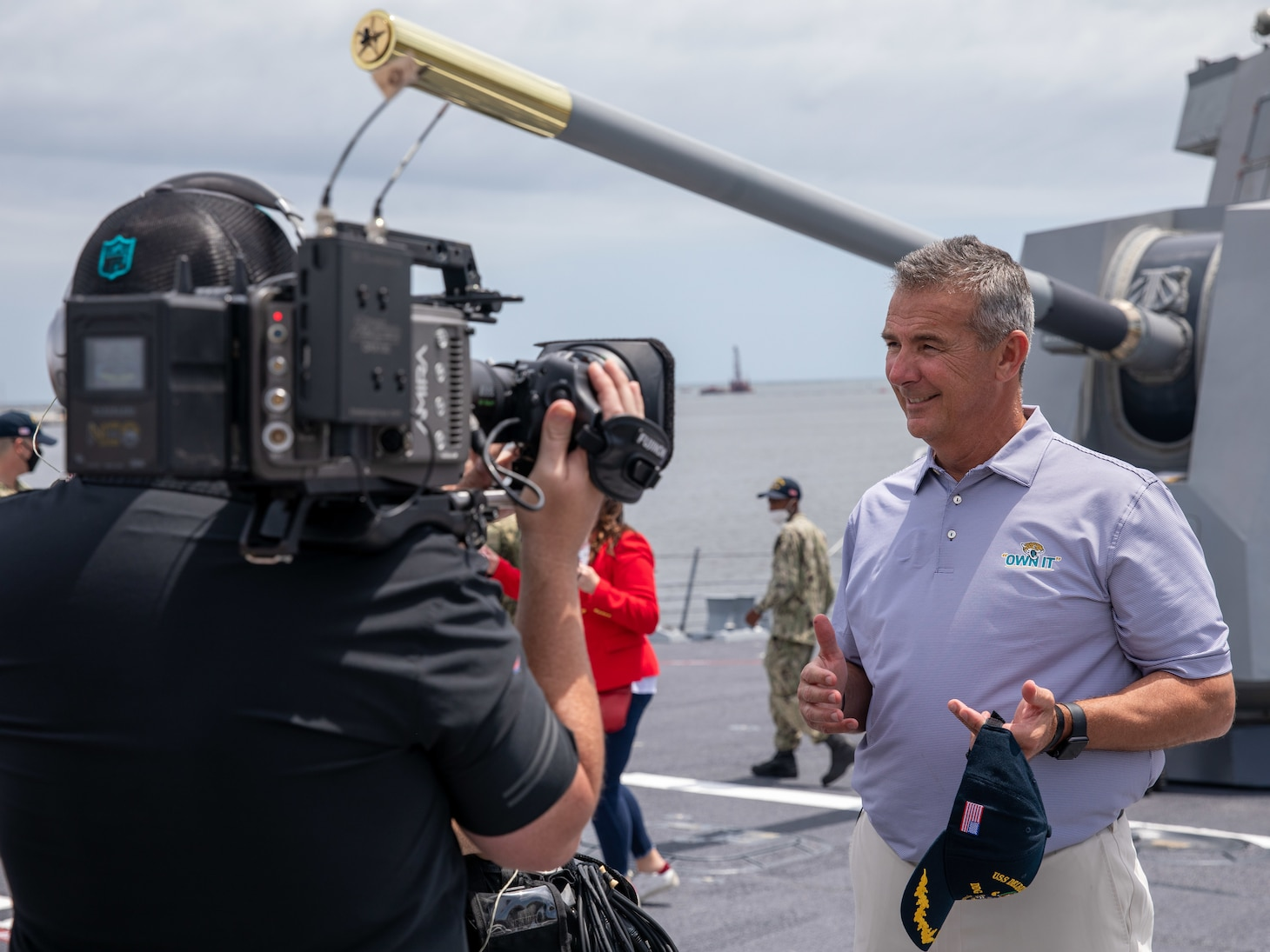Jacksonville Jaguars head coach Urban Meyer addresses various media outlets aboard the Arleigh-Burke class guided-missile destroyer USS Delbert D. Black (DDG 119).