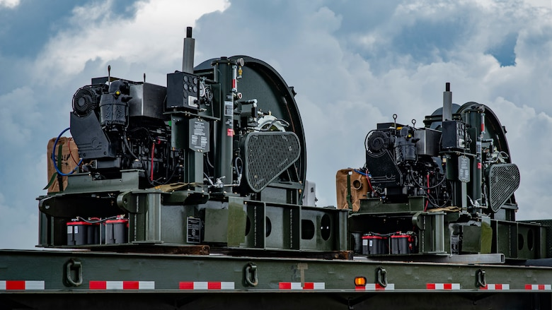 Two Barrier Arresting Kits sit on a trailer on the flight line at Andersen Air Force Base, Guam, April 26, 2021.