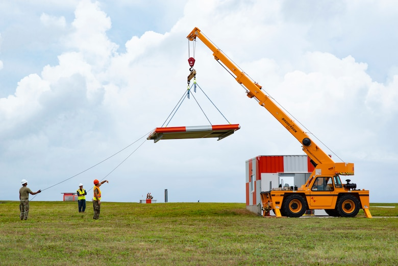 Members of the 36th Civil Engineer Squadron remove the roof of one of the Barrier Arresting Kit shelters in order to take out an old BAK-12 and replace it via crane at Andersen Air Force Base, Guam, April 26, 2021.