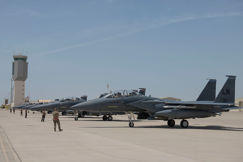 Six F-15E Strike Eagles assigned to the 494th Expeditionary Fighter Squadron (EFS) line up on the flightline at Al Dhafra Air Base, United Arab Emirates, April 25, 2021.