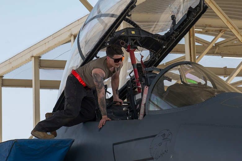 A crew chief assigned to the 380th Expeditionary Maintenance Group performs post-flight procedures on an F-15E Strike Eagle at Al Dhafra Air Base, United Arab Emirates, April 25, 2021.