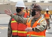 Col. Michael Ludwick, commander of 595th Transportation Brigade (SDDC), gestures while he describes port operations to Brig. Gen. Justin M. Swanson, the deputy commanding general of the 1st Theater Sustainment Command, while on Swanson's April 24, 2021 tour of Kuwait's Port Shuaiba. The 595th TB (SDDC) integrates and synchronizes surface deployment and distribution capabilities to project readiness and sustain the warfighter throughout the U.S. Central Command area of operations.