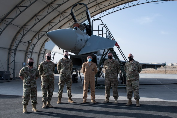 U.S. Air Force Col. Henry H. Triplett, 386th Air Expeditionary Wing commander, and the Italian National Contingent Air Commander, Italian Air Force Col. Luca G. Vitaliti, celebrate the first operational takeoff for two F-2000 Eurofighter Typhoons at Ali Al Salem Air Base, Kuwait, April 20, 2021. Spending time and communicating continuously with coalition teammates provides opportunities to strengthen partnerships. (U.S. Air Force photo by Senior Airman Kristine Legate)