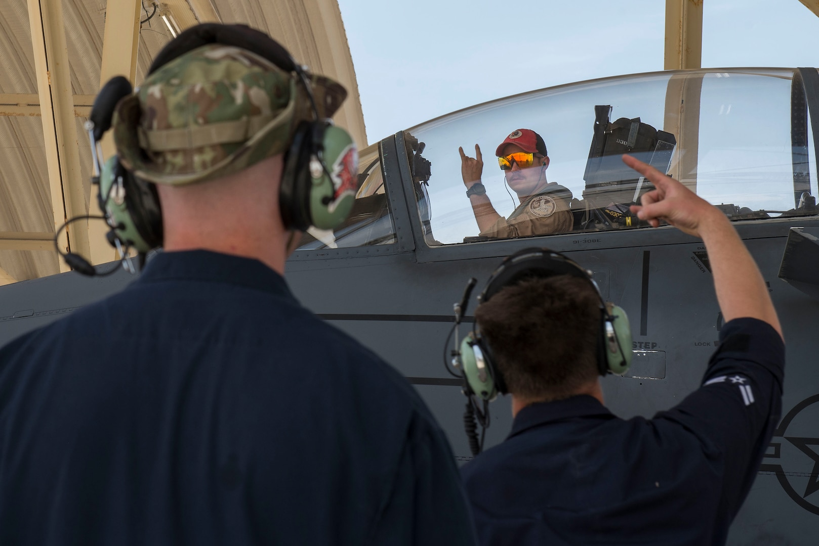A pilot assigned to the 494th Expeditionary Fighter Squadron (EFS) greets maintenance personnel assigned to the 380th Expeditionary Maintenance Group upon arrival to Al Dhafra Air Base, United Arab Emirates, April 25, 2021.