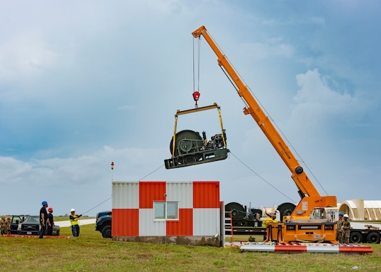 The 36th Civil Engineer Squadron removes an old Barrier Arresting Kit from the flight line at Andersen Air Force Base, Guam, April 26, 2021. According to the technical order, BAK-12s are overhauled and replaced every ten years. The BAK-12 feeds a cable across the flight line and, in the case of an in-flight emergency, acts as a mechanical barrier that rapidly decelerates a landing aircraft.