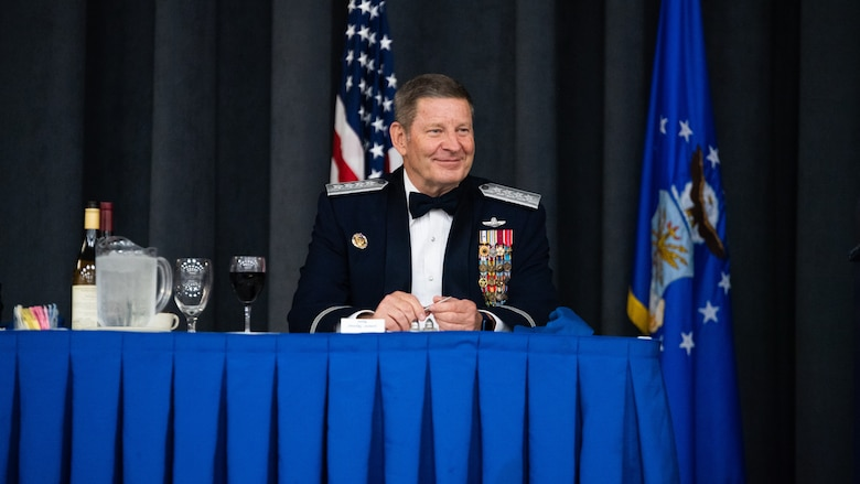 Retired Gen. Robin Rand, former Air Force Global Strike Command commander, sits at the head table during an Order of the Sword ceremony at Barksdale Air Force Base, Louisiana, April 23, 2021. The Order of the Sword is a rare honor bestowed on a senior officer or civilian by the enlisted corps of a command. (U.S. Air Force photo by Airman 1st Class Jacob B. Wrightsman)